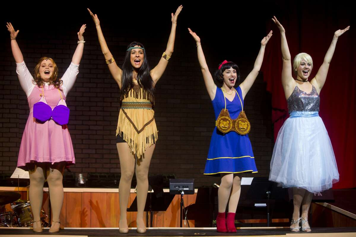 From left, Danella Hellus of Freeland as Sleeping Beauty, Brooke Gomez of Saginaw as Pocahontas, Tara Besso Ell of Midland as Snow White and Emily Rupp of Saginaw as Cinderella perform a scene during a dress rehearsal on Wednesday, Jan. 10, 2018 at the Midland Center for the Arts for Center Stage Theatre's production of Disenchanted. The show debuts Saturday and will run through Jan. 27. (Katy Kildee/kkildee@mdn.net)