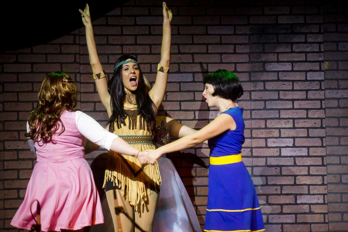 From left, Danella Hellus of Freeland as Sleeping Beauty, Brooke Gomez of Saginaw as Pocahontas and Tara Besso Ell of Midland as Snow White perform a scene during a dress rehearsal on Wednesday, Jan. 10, 2018 at the Midland Center for the Arts for Center Stage Theatre's production of Disenchanted. The show debuts Saturday and will run through Jan. 27. (Katy Kildee/kkildee@mdn.net)