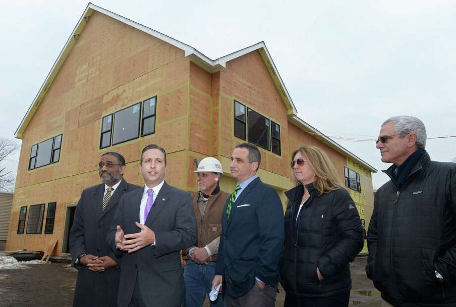 State Rep. Bruce Morris, D-Norwalk, and State Senate Majority Leader Bob Duff, D-Norwalk, officially announce Thursday that the General Assembly has included funding in the recently approved state budget to help complete construction of a permanent middle school facility for Side by Side Charter School while A.V. Tuchy job superintendent Neil Esposito, Side by Side School Director Matthew Nittoly, parent member of the school's Board of Representatives Kimber Grimm and Stein Troost Architecture principal Michael Stein look on at the school at 10 Chestnut St. in Norwalk. Photo: Erik Trautmann / Hearst Connecticut Media / Norwalk Hour