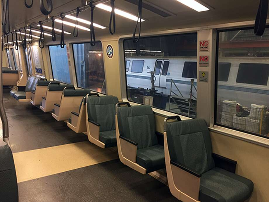 Some BART trains with modified seating plans now feature longer hand-holding straps, more easily accessible to shorter passengers. Photo: BART