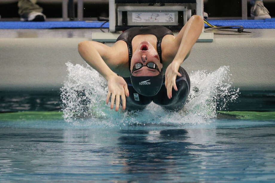 The Woodlands' Lucie Nordmann competes in the girls 100-yard backstroke during the Class 6A UIL Swimming and Diving State Meet on Saturday, Feb. 18, 2017, in Austin. (Michael Minasi / Chronicle) Photo: Michael Minasi, Staff Photographer / © 2017 Houston Chronicle
