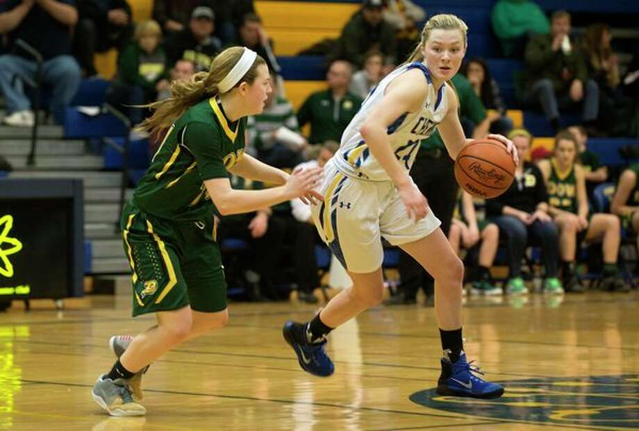 In this Daily News file photo, Midland High's Maddie Barrie tries to get past Dow High's Molly Davis in a game during the 2016-17 season.