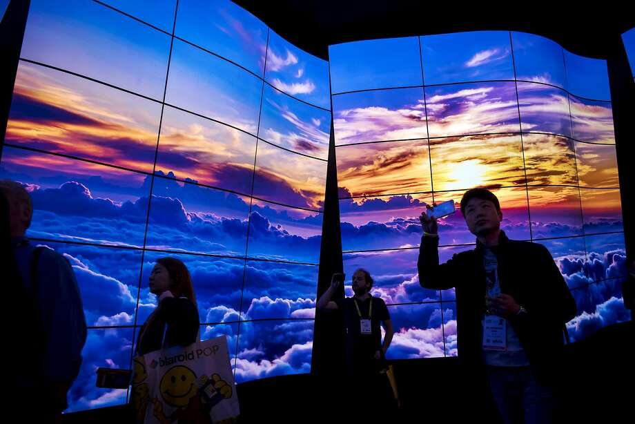 Attendees walk through the entrance to the LG Electronics booth during the 2018 CES in Las Vegas. Some items being displayed are a bit less practical than televisions. Photo: David Paul Morris, Bloomberg