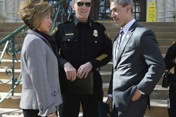 City Manager Sheryl Sculley (left) and Mayor Ron Nirenberg (right) meet with Chief William McManus.