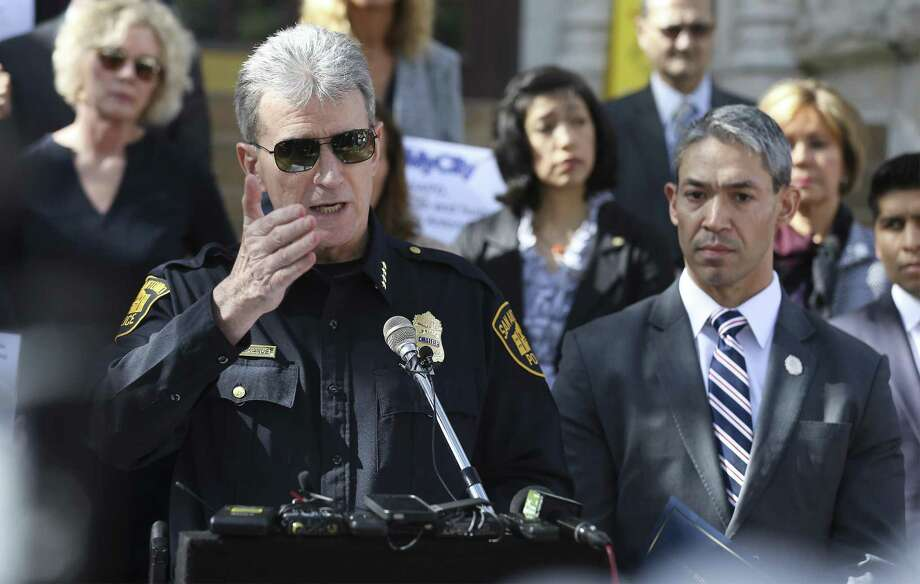 San Antonio Police Chief William McManus fields questions during a press conference to raise awareness of human trafficking on the steps of City Hall on Thursday, Jan. 11, 2018. Mayor Ron Nirenberg (right) was quick to show support for McManus who has become embroiled in an investigation concerning the release of immigrants in a human smuggling case which occurred on December 23. District 6 Councilman Greg Brockhouse sent a letter to the U.S. Attorney General's Office to investigate the handling of human smuggling incident by San Antonio Police. McManus has maintained that the department and his officers abided by proper procedure and had no jurisdiction to hold the immigrants which were released to the Refugee and Immigration Center for Education and Legal Services (RAICES) and Catholic Charities. (Kin Man Hui/San Antonio Express-News) Photo: Kin Man Hui, Staff / San Antonio Express-News / ©2018 San Antonio Express-News