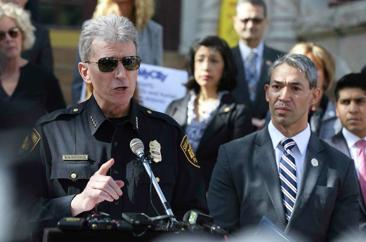 San Antonio Police Chief William McManus and Mayor Ron Nirenberg address the media in 2018 during a press conference about human trafficking. A reader questions rethinking police funding.