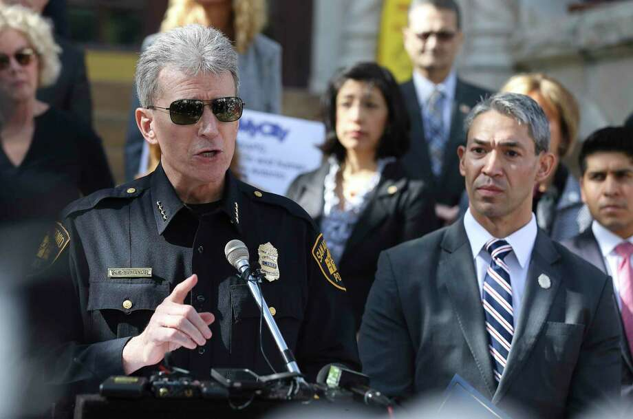 San Antonio Police Chief William McManus and Mayor Ron Nirenberg address the media in 2018 during a press conference about human trafficking.  A reader questions rethinking police funding. Photo: Kin Man Hui /San Antonio Express-News / ©2018 San Antonio Express-News