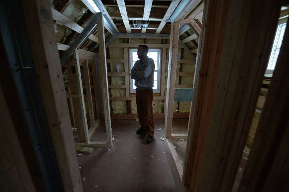 Interim Norwalk Recreation and Parks Director, Ken Hughes, tours the apartment at the 1802 farmhouse at Fodor Farm Thursday, January 11, 2018, in Norwalk, Conn. Now that the majority of the renovations on the farmhouse are complete, the Recreation and Parks Department is working to renovate the attached apartment, which will house a caretaker. Similar to Cranbury Park, the caretaker will take care of the property and oversee events at the property in exchange for reduced rent. Photo: Erik Trautmann / Hearst Connecticut Media / Norwalk Hour