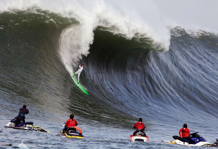 Nic Lamb rides a wave during the third heat of the first round of the Mavericks Invitational big wave surf contest Friday, Jan. 24, 2014, in Half Moon Bay, Calif. (AP Photo/Eric Risberg) Photo: Eric Risberg, Associated Press