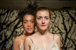"Sister-cousin-playmate-slave-mistress Zuri (Dezi Sol�y) and Emily (Emily Serdahl)�navigate their changing roles as they shed girlhood in AlterTheater's ""Bondage."""