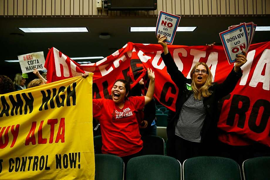 Tenant rights supporter Leticia Arce (center) and an advocate for landlord rights rally in Sacramento over a measure to repeal the Costa-Hawkins Rental Housing Act, which limits the rent control rules cities and counties may adopt. Photo: Gabrielle Lurie, The Chronicle