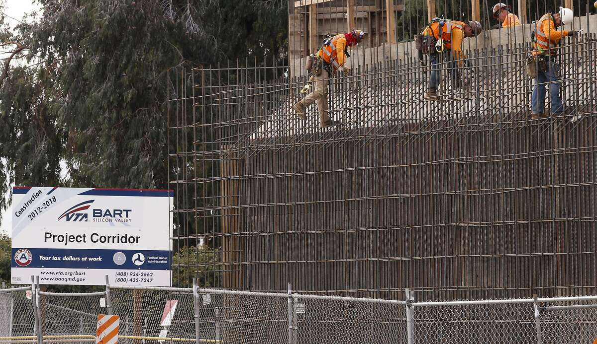 Workers build an overhead support system to hold the BART tracks where they cross above Berryessa Rd., just north of the station,as construction of the Berryessa BART station and surrounding corridor continues as seen on Tuesday Nov. 18, 2014 in San Jose, Calif.
