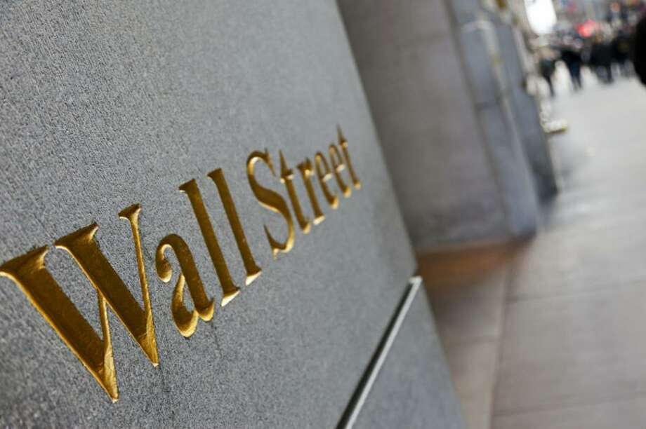 First-year investment bankers, whose salaries were once protected in an effort to encourage the rising stars of the future, may face pay freezes amid a slump in trading revenue on Wall Street. Photo: File Photo / File Photo / Stamford Advocate File Photo
