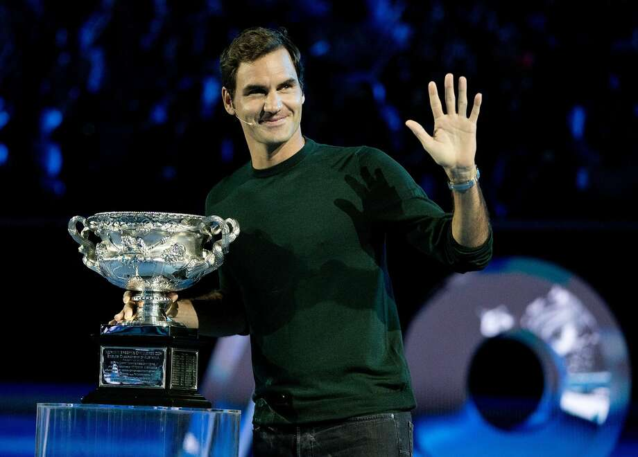Defending men's singles champion Switzerland's Roger Federer waves to the crowd during a ceremony for the official draw at the Australian Open in Melbourne. Photo: Mark Baker, Associated Press
