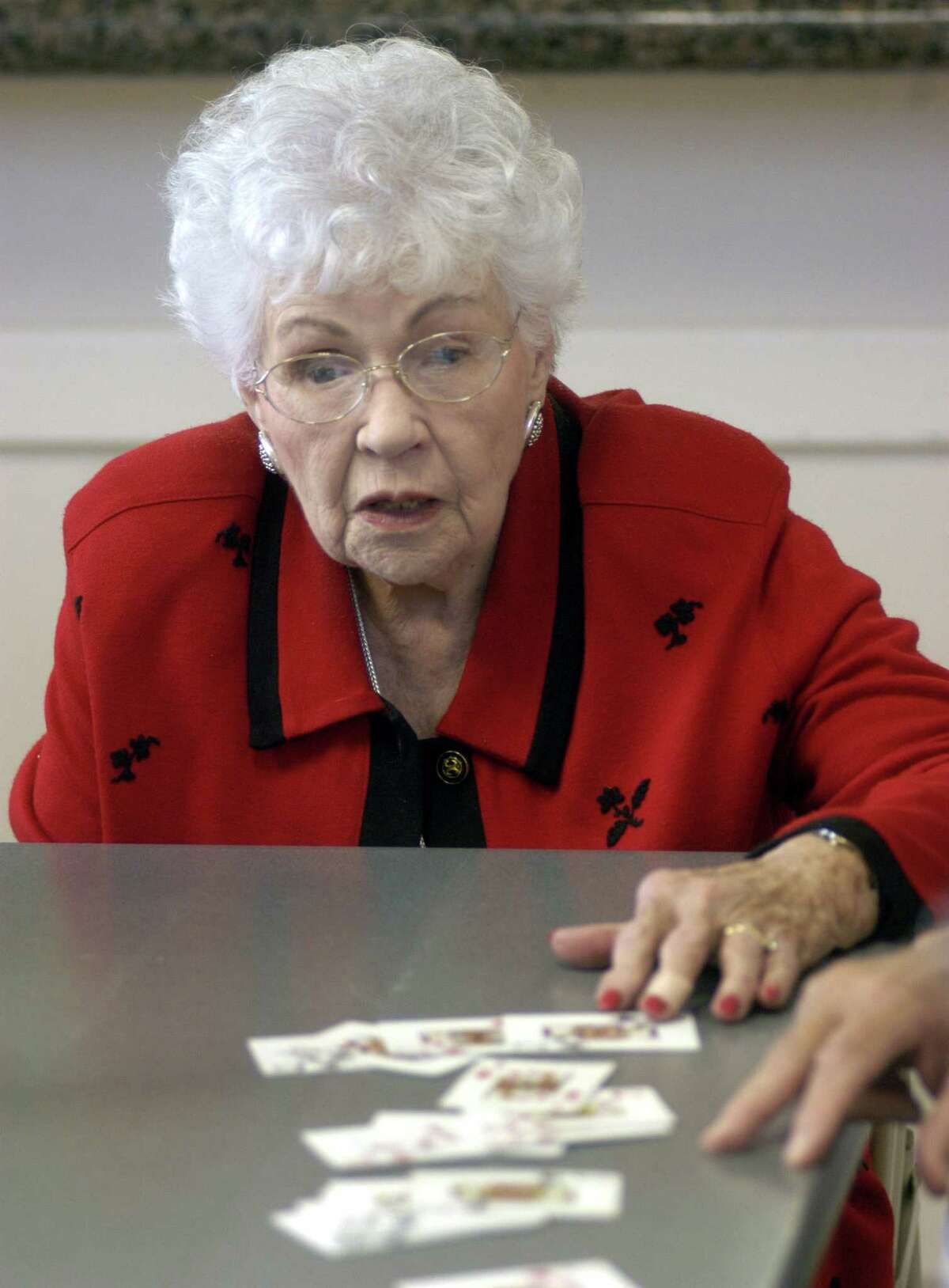 Vera May helps fellow players during a game of Pinochle at the May Community Center in Huffman Dec.15,2003.(Dave Rossman/Special to the Chronicle)