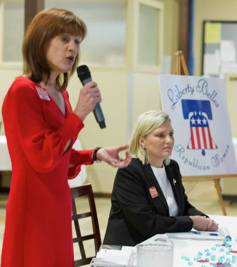 Jo Anne Linzer, Republican candidate for the 284th state District Court, listens as fellow candidate Kristin Bays speaks during a political forum at the Liberty Belles Republican Women meeting, Thursday, Jan. 11, 2018, in Panorama Village. Photo: Jason Fochtman, Staff Photographer / © 2018 Houston Chronicle