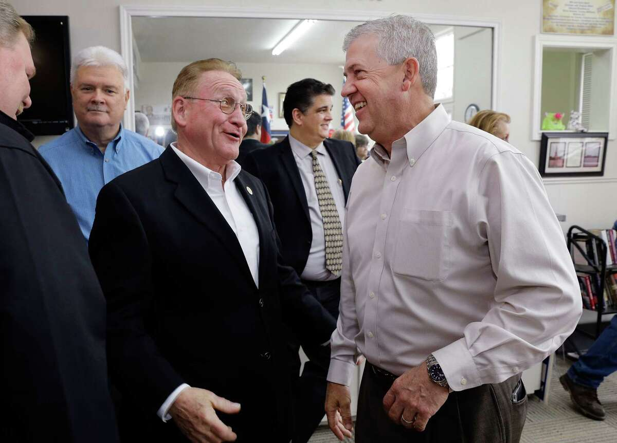 Montgomery County Judge Craig Doyal (right) and state Rep. Mark Keough exchange greetings before they draw numbers for ballot position at the county GOP office in Conroe, TX, Dec. 21, 2017. Both are vying to be county judge in a March 6, 2018 primary. (Michael Wyke / For the Chronicle)