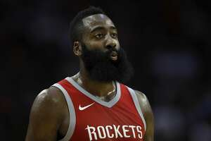 HOUSTON, TX - OCTOBER 30:  James Harden #13 of the Houston Rockets reacts to a basket in the first half against the Philadelphia 76ers at Toyota Center on October 30, 2017 in Houston, Texas.  NOTE TO USER: User expressly acknowledges and agrees that, by downloading and or using this photograph, User is consenting to the terms and conditions of the Getty Images License Agreement.  (Photo by Tim Warner/Getty Images)