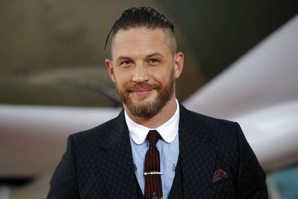 """Tom Hardy is set to play Eddie Brock in """"Venom."""" Pictured: Hardy poses for a photograph upon arrival for the world premiere of 'Dunkirk' in London on July 13, 2017."""