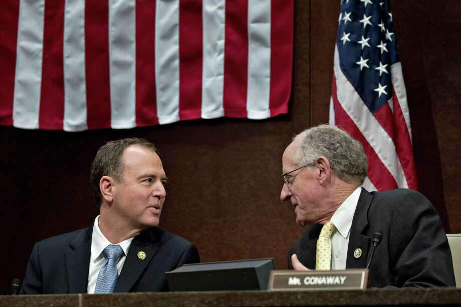 Rep. Adam Schiff, D-Calif., and ranking member of the House Intelligence Committee, left, speaks with Rep. Mike Conaway, R-Texas, before the start of a House Intelligence Committee hearing in Washington on Nov. 1. Photo: Bloomberg Photo By Andrew Harrer / Bloomberg