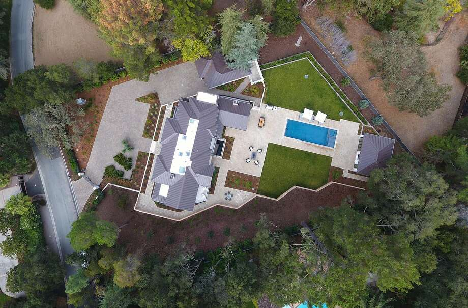 This aerial shot showcases 369 Fletcher Drive in Atherton, available for $18.75 million. Photo: Blu Skye Media
