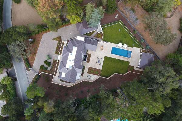 This aerial shot showcases 369 Fletcher Drive in Atherton, available for $18.75 million.