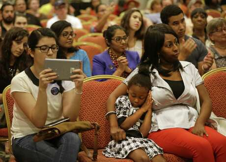 Artrinity Neal, 4, rests on the shoulder of her mother, Artrina Neal, during a public forum on Medicaid held by Congressman Al Green along with the Children's Defense Fund-Texas and others in Houston in 2017. A bill offers some help in allowing children in need to remain in Medicaid for one-year stints without renewal.