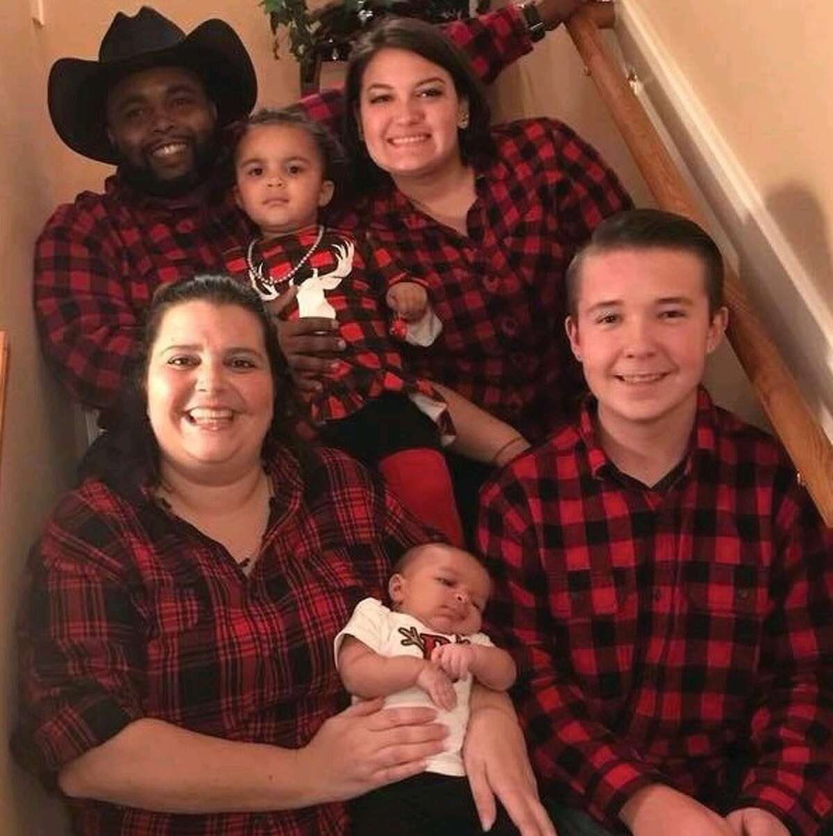 Derrick and Talicia Johnson are pictured with their children and nephew at Christmas. Less than a month later, their home was destroyed by fire.