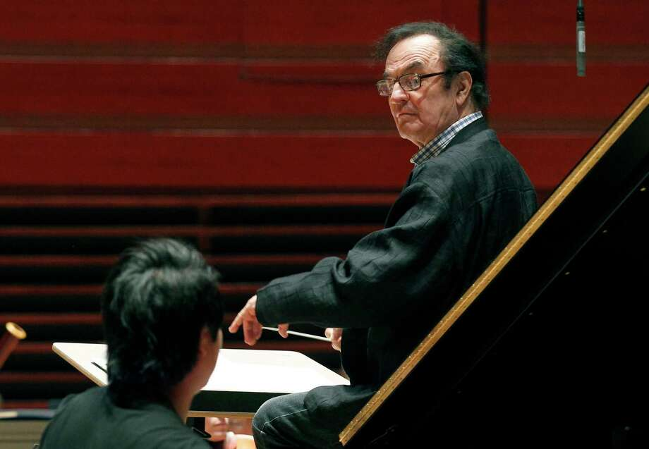 FILE - In this Oct. 19, 2011 file photo, world-renowned conductor Charles Dutoit, right, performs with the Philadelphia Orchestra during a rehearsal in Philadelphia. Dutoit has stepped down early from his role as artistic director and principal conductor of the Royal Philharmonic Orchestra following allegations of sexual misconduct, the orchestra said Wednesday, Jan. 10, 2017. (AP Photo/Alex Brandon, File) Photo: Alex Brandon, STF / Copyright 2017 The Associated Press. All rights reserved.