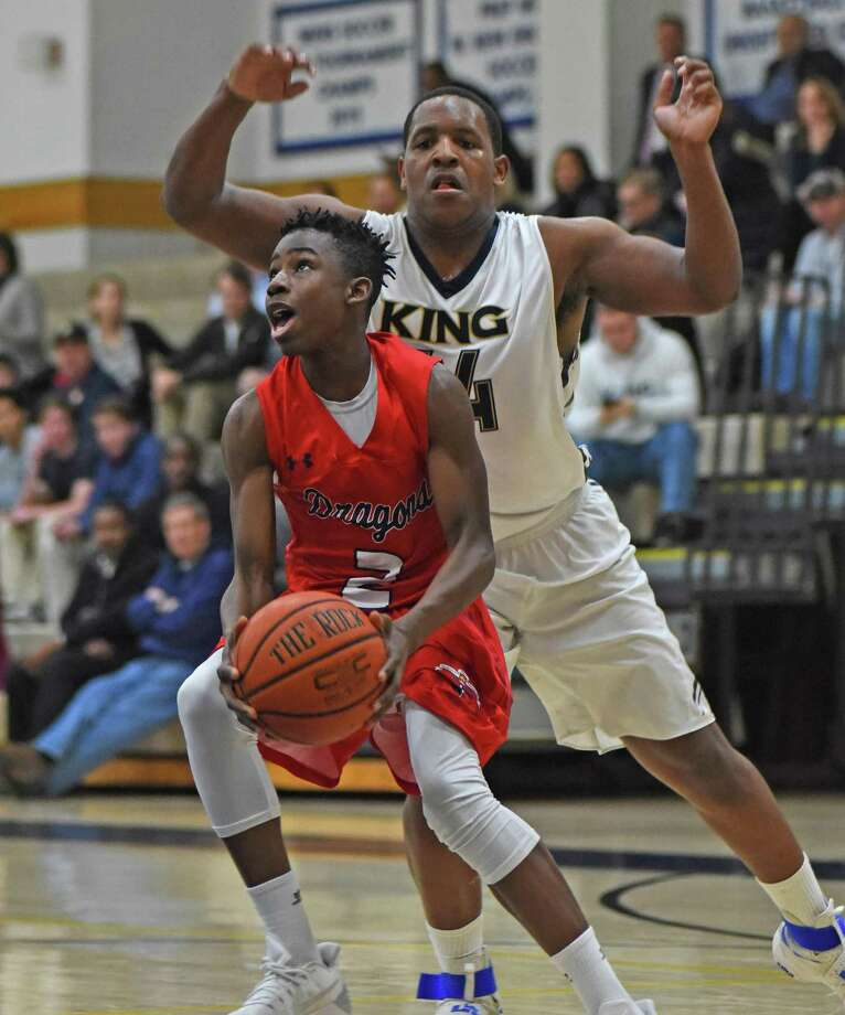 GFA guard Kobi Agard, left, prepares to power up to the basket as King's Evan Henry, rear, comes in to defend during Thursday's game at Coyle Gym in Westport. Photo: John Nash / Hearst Connecticut Media