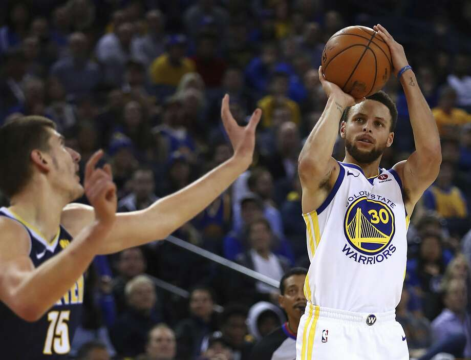 Golden State Warriors' Stephen Curry, right, shoots against Denver Nuggets' Nikola Jokic (15) during the second half of an NBA basketball game Monday, Jan. 8, 2018, in Oakland, Calif. Golden State won, 124-114. (AP Photo/Ben Margot) Photo: Ben Margot, Associated Press