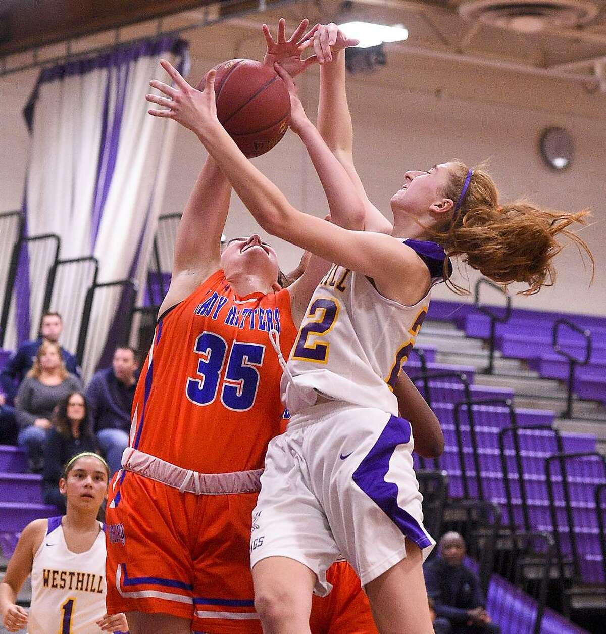 Danbury's Emily Grenier (35) fights for a rebound with Westhill's Grace Hansen (22) during a FCIAC girls basketball game at Westhill High School in Stamford, Conn. on Thursday, Jan. 11, 2018.