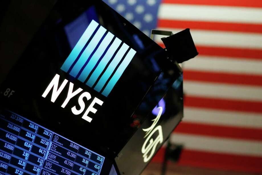 FILE - In this Wednesday, Dec. 27, 2017, file photo, a logo for the New York Stock Exchange is displayed above the trading floor. Stocks are rising at the start of trading Thursday, Jan. 11, 2018, led by homebuilders and airlines. (AP Photo/Mark Lennihan, File) Photo: Mark Lennihan, STF / Copyright 2017 The Associated Press. All rights reserved.