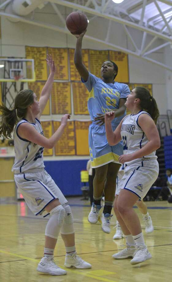 Kolbe's Trinity Bravo (23) shoots over Newtown's Kira Smith (22) and Nicole DePra (21) in the girls basketball game between Kolbe Cathedral and Newtown high schools, Thursday night, January 11, 2018, at Newtown High School, in Newtown, Conn. Photo: H John Voorhees III / Hearst Connecticut Media / The News-Times