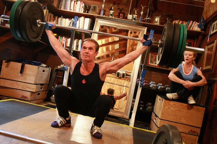 TRAINER18_0484_LKM.jpg  Jerzy Gregorek trains for weightlifting under the watchful eye of his wife Aniela Gregorek (at right).  The Gregorek's train weightlifters as well as personal fitness clients out of their Woodside, CA home.      (Laura Morton/Special to the Chronicle)