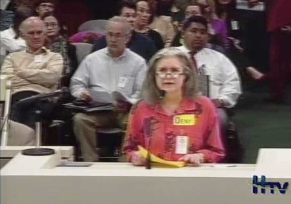 A screenshot of Mary Cerruti speaking at a city of Houston Planning Commission meeting in 2013 shows her wearing glasses.