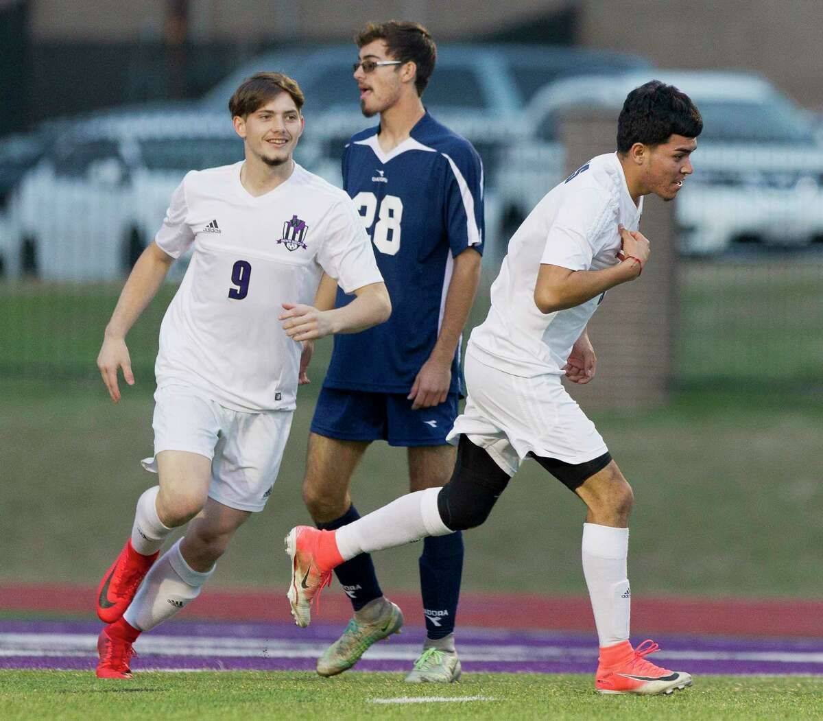 Willis' Luis Alberto Torres (3) reacts after scoring a goal beside Austin Eugene Phillips (9) in the first period of a match during the Willis Wildkat Showcase at Lynn Lucas Middle School, Saturday, Jan. 6, 2018, in Willis.