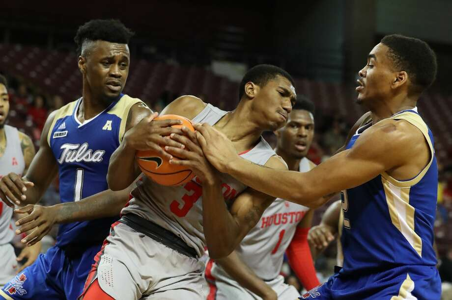 Houston guard Armoni Brooks (3) gets a rebound from Tulsa forward Martins Igbanu (1) and Tulsa forward DaQuan Jeffries (2) during second-half action at H&PE Arena, TSU Campus Thursday, Jan. 11, 2018, in Houston. ( Steve Gonzales / Houston Chronicle ) Photo: Steve Gonzales/Houston Chronicle