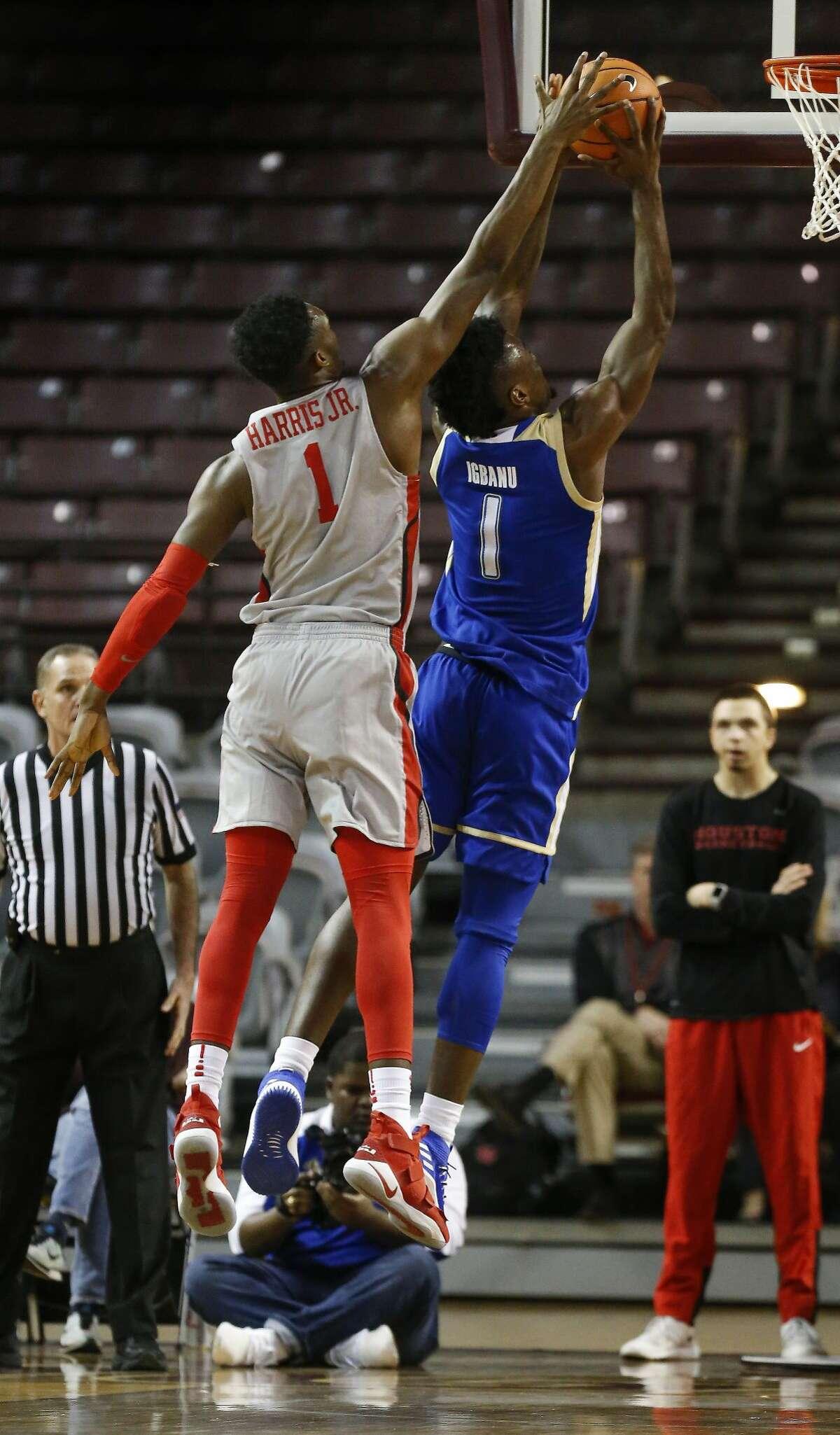 Houston center Chris Harris Jr. (1) blocks a shot by Tulsa forward Martins Igbanu (1) during first-half action at H&PE Arena, TSU Campus Thursday, Jan. 11, 2018, in Houston. ( Steve Gonzales / Houston Chronicle )