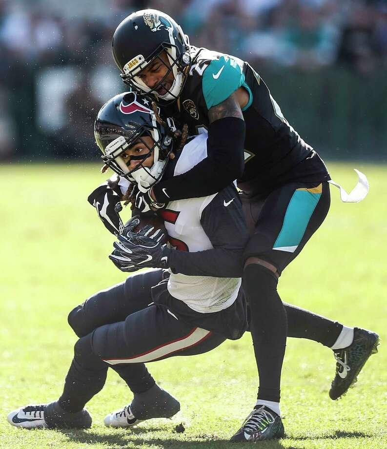 Jacksonville Jaguars cornerback A.J. Bouye (21) tackles Houston Texans wide receiver Will Fuller (15) during the second quarter of an NFL football game at EverBank Field on Sunday, Dec. 17, 2017, in Jacksonville. ( Brett Coomer / Houston Chronicle ) Photo: Brett Coomer, Staff / © 2017 Houston Chronicle