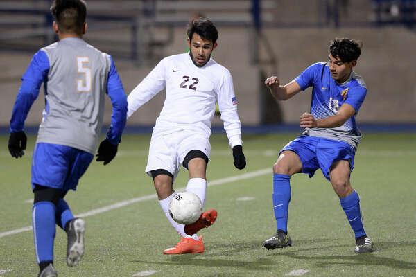 Lee's Daniel Santos Barron (22) keeps the ball away from El Paso Eastwood on Jan. 11, 2018 at Grande Communications Stadium. James Durbin/Reporter-Telegram