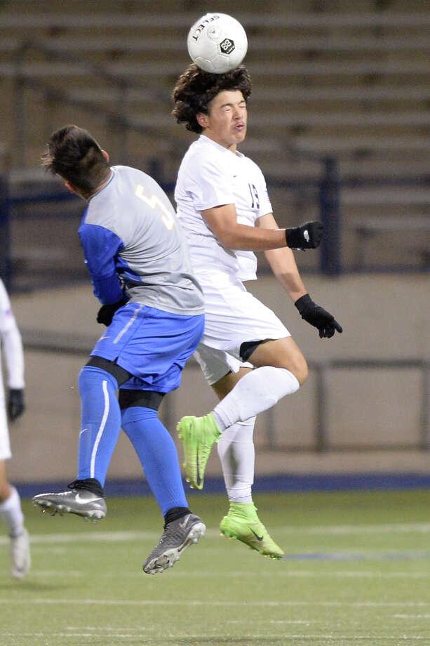 Lee's Marco Jurado (19) heads the ball against El Paso Eastwood (5) on Jan. 11, 2018 at Grande Communications Stadium. James Durbin/Reporter-Telegram Photo: James Durbin