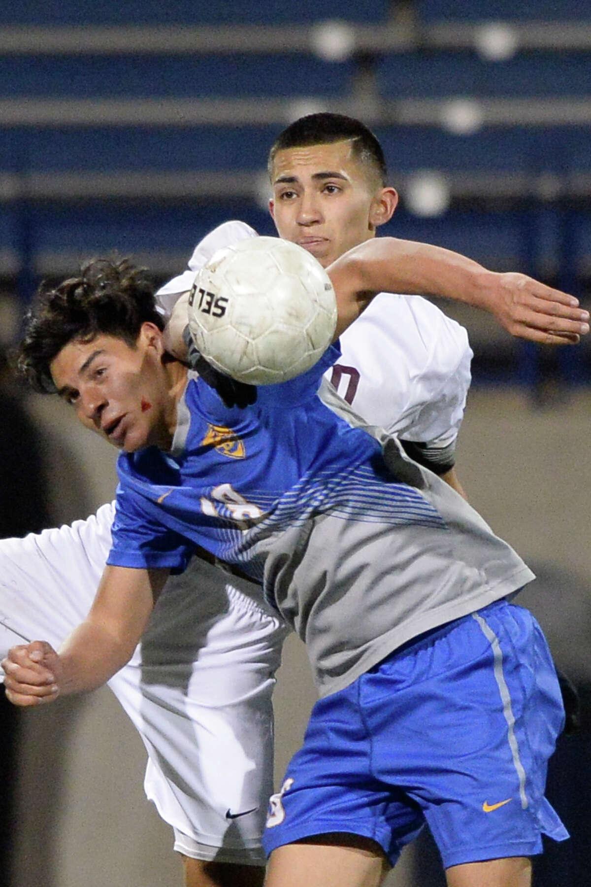 Lee's Luis Aranda (10) heads the ball against El Paso Eastwood (18) on Jan. 11, 2018 at Grande Communications Stadium. James Durbin/Reporter-Telegram