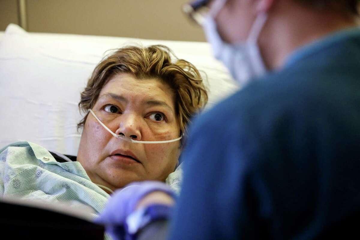 Sara Jimenez, left, a flu patient, talks about her care with Jennifer Brown, a nurse, at Houston Methodist Hospital, Thursday, Jan. 11, 2018, in Houston.