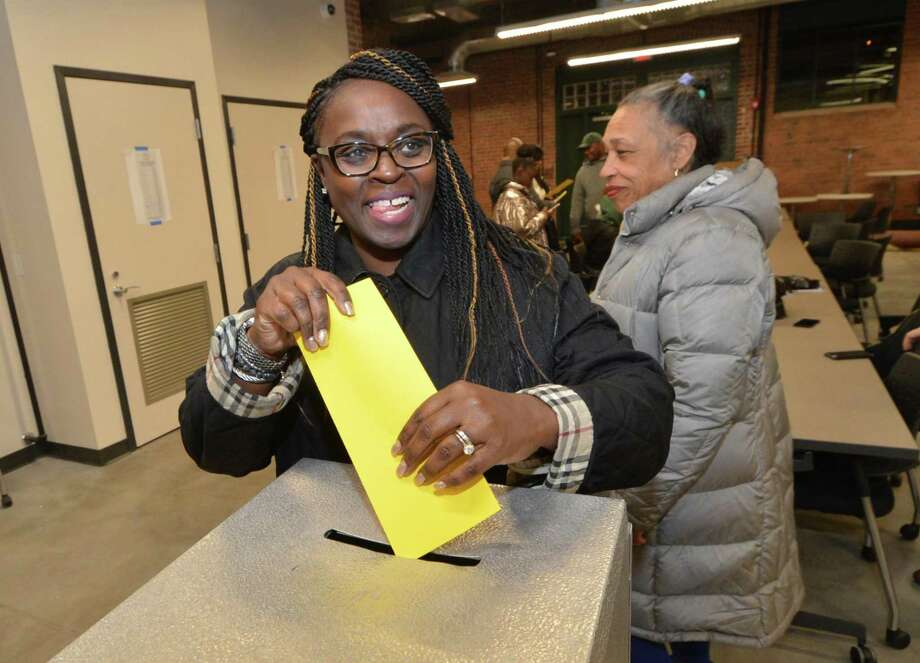 Sandra Stokes casts her ballot for the members of the Democratic Town Committee District B during the District B caucus at the Smilow SoNo Life Center on Thursday. Photo: Alex Von Kleydorff / Hearst Connecticut Media / Norwalk Hour
