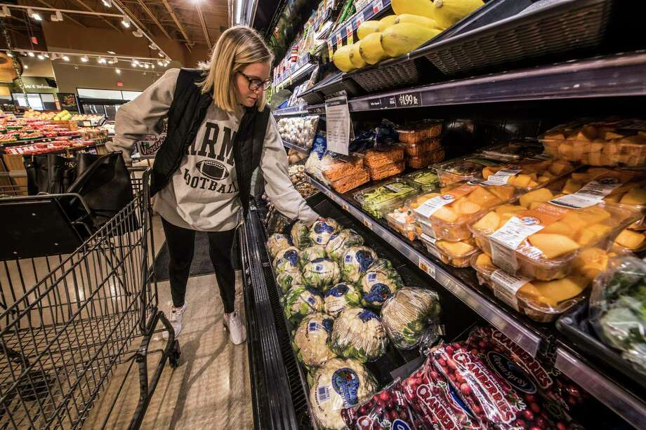 Dakota Kaplan, 23, of Watervliet shops the produce section of the Price Chopper Thursday Jan 11, 2018 in Watervliet, N.Y.   (Skip Dickstein/ Times Union) Photo: SKIP DICKSTEIN / 20042643A