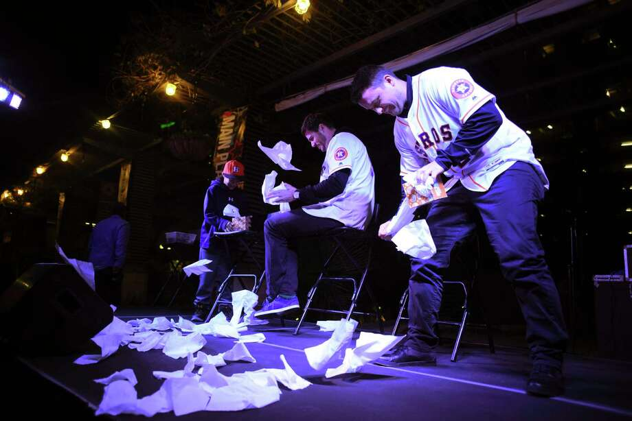J.D. Davis, right, and James Hoyt of the Houston Astros participate in a tissue paper game during their stop in Main Plaza to greet fans during their Astros Caravan tour on Thursday, Jan. 11, 2018. Photo: Billy Calzada, San Antonio Express-News / San Antonio Express-News