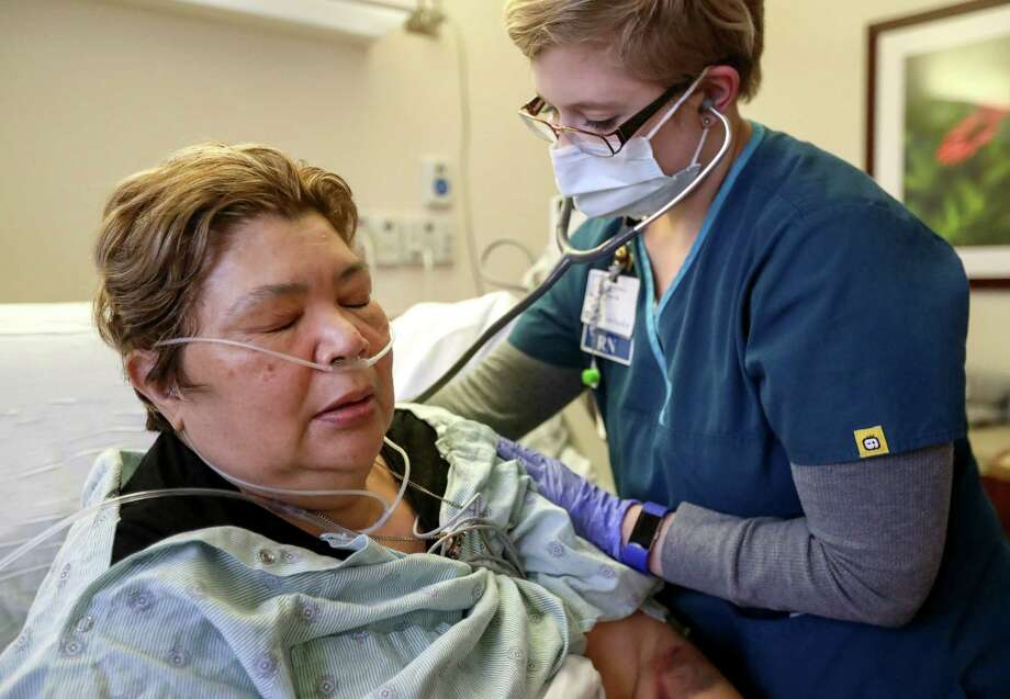 FILE - Sara Jimenez, left, a patient at Houston Methodist, was turned away from two emergency departments. Wednesday, county officials announced two Houston-area women in their 40s had died of flu-related causes. Photo: Jon Shapley, Houston Chronicle / © 2017 Houston Chronicle