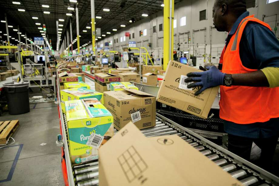 FILE --  A worker inside a Walmart fulfillment center in Bethlehem, Pa., Oct. 12, 2017. Citing tax cuts, the nationé•s largest private employer said on Jan. 11, 2018, that it would raise its starting wages, give bonuses to some employees and vastly expand maternity and parental leave benefits for its army of more than one million hourly workers. (Sam Hodgson/The New York Times) Photo: SAM HODGSON, STR / NYTNS