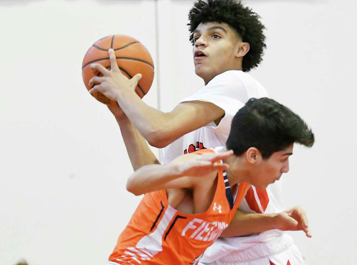 Albany Academy's Andre Jackson (22) moves the ball against Fieldston School players during a boys high school basketball game on Saturday, Jan. 6, 2018, in Albany, N.Y. (Hans Pennink / Special to the Times Union)